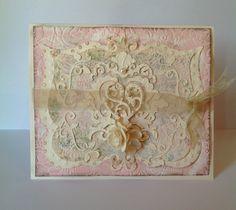 Cricut Cartridges;  Fancy Frames, Damask Decore, Wall Decore, Flower Shoppe.  Poppy embossing folder.
