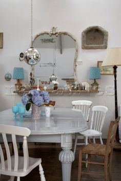 Painted dining table and mismatched chairs Cornwall UK