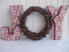 "Would love to make this with paper mache letters wrapped in twine and/or evergreen-look garland, with a wreath for the ""O"" and berries/cardinal/pinecones. wide red ribbon hanger with a big bow at the top :) Christmas Time Is Here, All Things Christmas, White Christmas, Joy Holiday, Holiday Crafts, Letter Wreath, Paper Mache Letters, Fun Crafts For Kids, Diy Weihnachten"