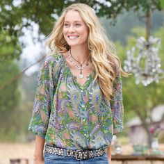A watercolor profusion of paisleys recalls Monet's water garden. Silk crinkle chiffon is gentled by a shirred neckline and elasticized raglan...
