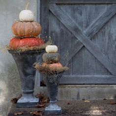 Our favorite flared urns become the base for a pair of pumpkin towers. Link in profile to shop the look!