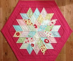 """Rock Candy"" by Jaybird Quilts. Charm pack friendly. The 2"" finished diamonds are cut using ""Sidekick"" ruler also by Jaybird Quilts.  Measures 20.5"" x 23""."