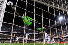 Iker Casillas attempts to make a save during the Copa del Rey Final between Real Madrid CF and FC Barcelona at Estadio Mestalla on April 16, 2014 in Valencia, Spain.