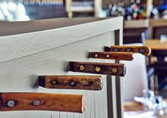 (Interior Details and Signage for Edmund's Oast) Novel hanging hooks made from knives with interesting handles