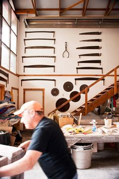"""House Profile: Artistic Legacy in Ancram , NY. This is the former home of modern English sculptor Anthony Caro, now home to large-scale clay artist, Paul Chaleff. """"The studio is definitely a place full of boy toys,"""" he says, smiling. Everything here is on wheels, including work tables and what seem like dozens of laundry-cart-size plywood boxes that hold tools, materials, and works in progress. (photo: Deborah DeGraffenreid)"""