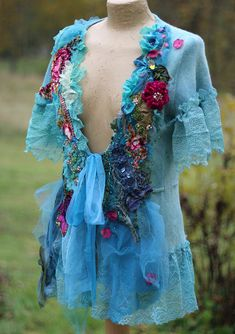 Romantic bohemian cardi, mohair blend, has been hand dyed in shades of aqua, turquoise, blue..reworked with various vintage textiles, trims and laces. The bottom edge and sleeve edges are trimmed with contemporary lingerie laces, hems are adorned with tulle, trims and embroidery.Other