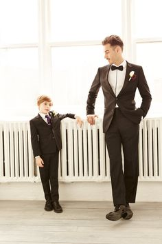 Two cuties in classic black tuxes