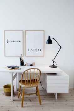 Clean lines of a modern work desk paired with a rounded old chair in a Scandinavian home office. Design by Loft Stockholm.