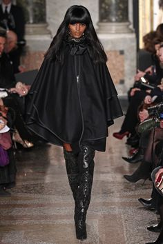Milan Shoe of the Day: Emilio Pucci  The thigh-high suede boots that paraded down the runway added a righ finish, especially those incorporating pony hair and laser-cut leather in a paisley pattern. For More
