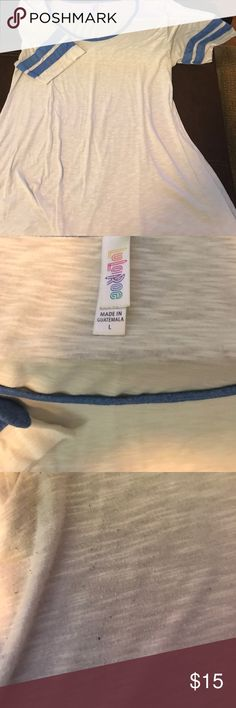 Lularoe Perfect T Large Lularoe Perfect T Size large. There is some pilling and this has been worn. I bought it from poshmark recently and it just doesn't fit me right. LuLaRoe Tops