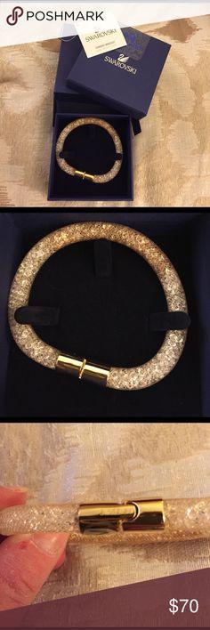 NEW AUTHENTIC SWAROVSKI STARDUST BRACELET New authentic Swarovski stardust bracelet..champagne color with gold clasp..in crystal and champagne..size 20cm..comes with original box..brand new..refer to pics Swarovski Jewelry Bracelets