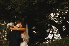 Bride and groom embrace under the trees  Kirkley Hall Wedding Photography Newcastle Indian Wedding Photography  Image by ARJ Photography