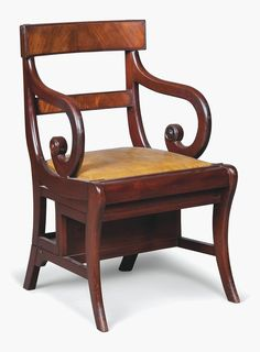 A Mahogany Metamorphic Library StepArmchair. Estimate £1,000-1,500. This lot is…