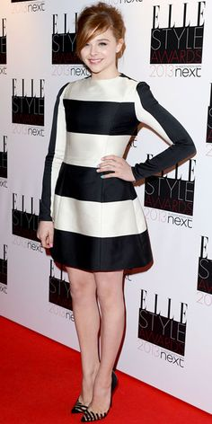 Chloe Moretz stood out in a striped black and White dress and Louboutins shoes