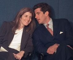 John F. Kennedy, Jr. leans over to say something to his sister, Caroline, Friday, May 29, 1998 in Boston during the annual Profile in Courage Award
