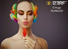 This week free image by frugo. #123rf #free Download at http://www.123rf.com/photo_12962354_beautiful-young-female-face-with-bright-fashion-multicolored-make-up--feathers.html?referredby=Julie=123rfjulie