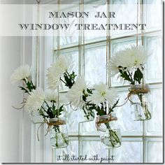 As much as I hate to admit it lace curtains are not the only answer to window decor.  Mason Jars with flowers works for me.