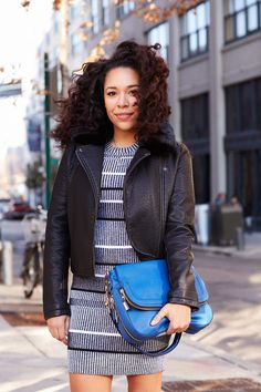 """""""One way you can inject your personality into your work wardrobe is through accessories. I love bringing contrast to a look. My clothing is mostly muted — blacks, grays, and other neutrals — so throwing in a pop of color like with this blue bag gives the look a little more bang and really helps to bring everything together."""""""