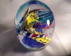 A personal favorite from my Etsy shop https://www.etsy.com/listing/219667201/hand-blown-glass-art-paperweight