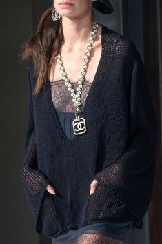 Chanel Spring Summer Collection is a throwback to the early 1990s with oversized chains and giant earrings.