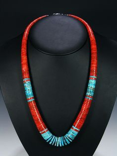 """A single strand of beautiful turquoise and apple coral stones finished with a sterling silver claw clasp. Size: Necklace is 26"""" long."""