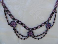 A simple necklace. The fire polished beads of the upper section are #3, Those at the flowers and lower sections are #4. You will need also seed beads #11 and #10 for the upper part and seed beads #11 and crystal bicons #3 for the lower chains. For the flowers use # 11 seed beads.