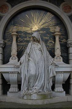 Woman sitting on grave, Illuminati sun  Seen at cimetery in Berlin, Alter Sankt Matthaeus Kirchhof