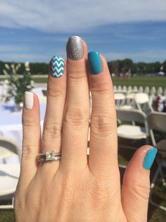 Blue white and silver glitter chevron nail art.