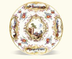 A Meissen Plate from the service presented to King Frederik V of Denmark, circa 1746-50 painted in the manner of Christian Friedrich Herold. Given in 1751 by Augustus III of Saxony and Poland to King Frederik V of Denmark.