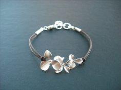 orchid flowers bracelet. $20.00, via Etsy.