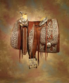 The last saddle owned by the legendary Mexican renegade and revolutionary hero Pancho Villa. Unique and historic, the saddle is covered in silver-wrapped threads over leather stump work. The dazzling piece was crafted for the revolutionary by some of the greatest Mexican artisans before Villa's 1923 assassination. In fact, hidden in amongst the domed silver conchos, the saddle bears the craftsmen's marks, whilst each stirrup is carved with his styled initials. (Sold for $ 718,000)