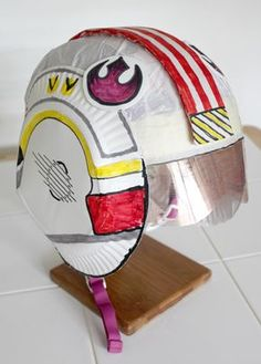 X-Wing Fighter Helmet made using a Bicycle helmet. Goes with the cute X-Wing Iron on t-shirt costumes Filth Wizardry made. For anyone with kids that are Star Wars fans she has some excellent tutorials on some great Star Wars stuff! X Wing Fighter, Fighter Pilot, Star Wars Party, Star Wars Birthday, Baseball Birthday, Birthday Cake, Star Wars Droids, Star Wars Rebels, Craft Space