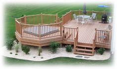 Inspiration: deck with hot tub space :: love this, but would make the hot tub space a gazebo!