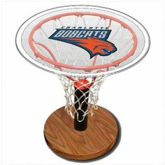 Charlotte Bobcats NBA Basketball Sports Table by Spalding. $139.95. Wood grain base. Unique display for your treasured basketball.. Assembled dimensions 24 inches H x 24 inches W x 24 Inches D.. Regulation size rim and authentic all-white net.. 24 inch diameter clear acrylic top with your favorite NBA team logo. Bring home team pride to your living room with the Charlotte Bobcats NBA Basketball Sports Table. This basketball hoop shaped coffee table features a large silk...