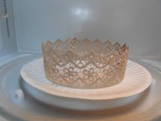 Update:  In January of 2013 I shared a second quick-method for making lace crowns that does not use a microwave.  Click HERE  for that tuto...