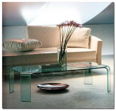 1. When decorating,with limited space, pick out furniture that can be seen through creating the optical illusion of more space. This glass table is a great alternative to your classic wood table. It lets the user still have a functional table, yet does not make you feel like you are sitting in a small living room space.