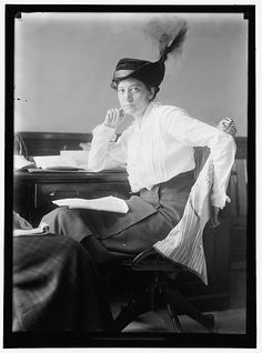 Ruth Hanna McCormick, 1880-1944    Suffragette, and  first woman featured on the cover of Time Magazine (1928),  she represented Illinois in the House of Representatives from 1929-1931. In this great candid, she sits at in her shirtwaist, wearing a great hat, her suit jacket draped on the chair and showing its striped lining. A second woman is just visible on the left of the photo, holding a notepad on her knee. An assistant? A coworker?