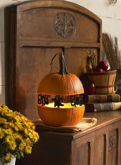 """Create """"Spook-tacular"""" silhouettes with Ghost/Boo Pumpkin Pegs™. They are reusable and fun! #halloween #DIY #plaidcrafts"""