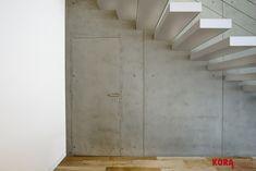 Skryté dvere v betónovej stene / Hidden doors in a concrete wall.