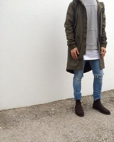 Olive parka + gray sweatshirt + long white t-shirt + distressed skinny denim + brown suede boots