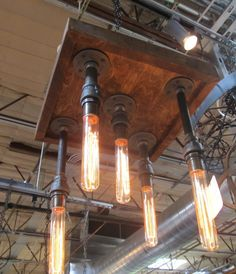 hand crafted hanging black pipe fitting 5 light fixture on Etsy, $275.00
