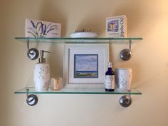 Small framed seascape painting perfect for intimate location.  Shown here with bath accessories.
