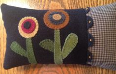 Love the French knots on the ric rac. 4 3/4 x 8. Kit includes black wool for top, wool for flower designs, cotton check fabric, ric rac, cotton backing, color photo and directions.