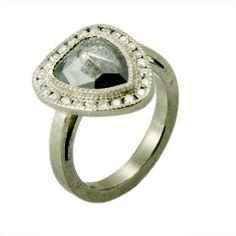 Palladium with natural colored black rose diamond center stone. Crazy and amazing.