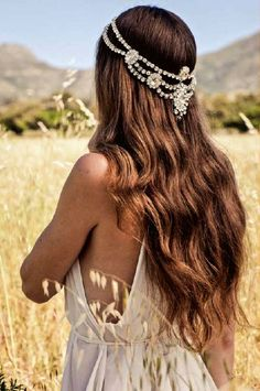 Love the glitz of this crown, as opposed to the usual floral style. Yet still suited to a rustic bride!