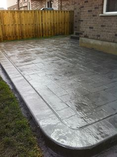Grand Ashlar Slate Stamped Concrete Patio with Rough Cut Border in London Ontario
