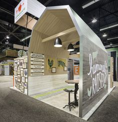 Contemporary barn in the Applegate trade show exhibit. This custom 20x20 exhibit packed a big punch on the show floor with the farm style conference space, ample sampling counter and reception counter.