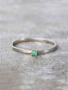A gossamer band of textured precious metal culminates in a perfectly petite sparkling jewel. Shown in Emerald. Available in Sterling Silver or 14K Solid Gold. Handcrafted with Love in NYC. Please allo