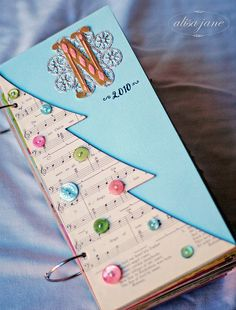 december daily - LOVE the Initial and the year on the front. Plus the buttons as ornaments! SO cute!