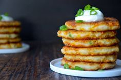 Cheesy Leftover Mashed Potato Pancakes make good use of leftover mashed potatoes by adding Cheddar, scallions, egg fried in pancake form and topped with sour cream. Leftover Mashed Potato Pancakes, Cheesy Mashed Potatoes, Mashed Potato Recipes, Potato Cakes, Cheddar Potatoes, Cheesy Recipes, Thanksgiving Leftover Recipes, Thanksgiving Leftovers, Thanksgiving Food